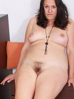 SuzanneElegant and brunette Suzanne from AllOver30 shoing off pussy hair