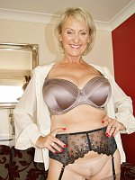 Sexy older blond Michelle wears sexy nylons shows her big tits