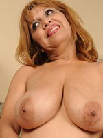 Marissa	47 year old and busty Marissa from AllOver30 tugs at her pussy lips
