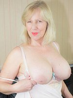 Curvy blonde-haired mature Sandy poses in sexy lingerie