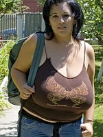 Milf with giant K cup tits is out in public and takes her top off