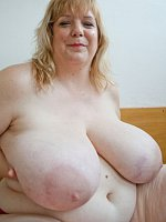 Blond bbw with heavy big tits plays with them and gets wet in the pussy