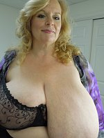 New super big breasted model Suzie is blond and sexy and takes out her massive hangers.
