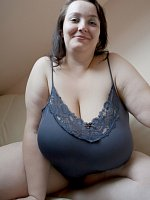 Getting out of her lingerie top this big boobs bbw has huge soft tits.