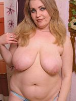 Mature chubby playing with mature tits and dildo
