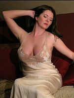 Brunette goddess' big bust in vintage pink silk.