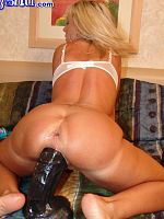 tiny blonde tackles some of the largest dildos on the planet.