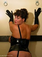 John my hubby wanted to take these photos for my Mistress Kim film i like dressing up in leather pvc I also love my collection of whips paddles really