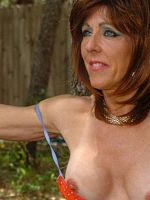 Older MILF SQUATS in the WOODS