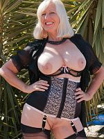 Sexy blonde mature Sandy loves to pose in sexy lingerie