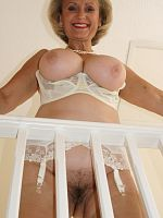 Amateur blonde MILF Michelle wears nylons and shows her big mature tits