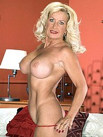 Blonde granny with huge pair of mature tits
