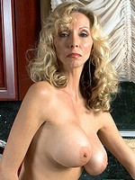Sexy house wife strips in kitchen