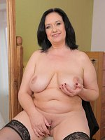 Ria Black - Elegant 48 year old Ria Black stuffs her pussy with a big black dong