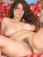 Tori strips to reavela big natural mature tits and a full bush