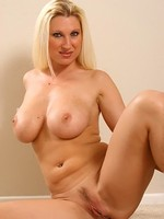 Blonde MILF Devon strips and spreads her long legs