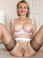 Blonde MILF Michelle exposing her big mature tits and pussy