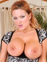 Seductive hot milf Sharon Pink pops out her massive mature tits while slowly taking off her sexy thongs